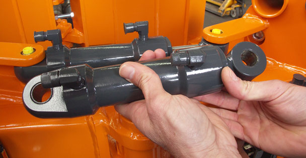 Polymer plain bearings in the various hinges, locks and hydraulic cylinders of the root ball transplanter.