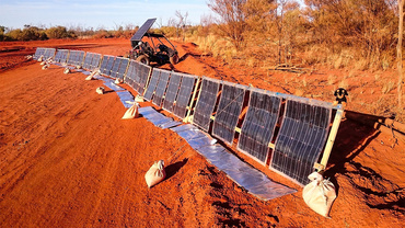 SolarBuggy and solar panels in Australian desert